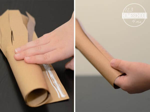 roll the construction paper to make a tree trunk