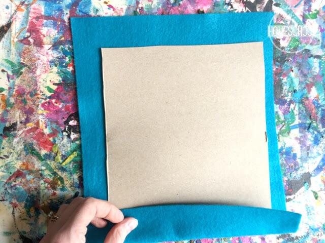 tape felt sheet onto cardboard rectangle
