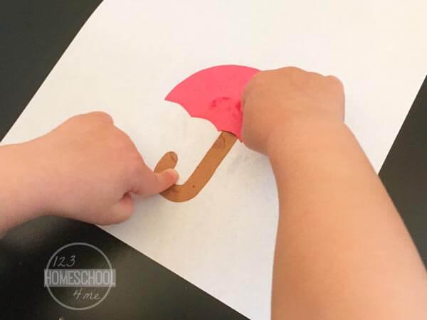 glue down the umbrella and umbrella stick on white paper