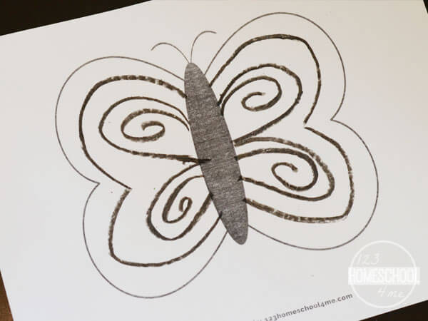 use black crayons to make designs on the butterfly wings