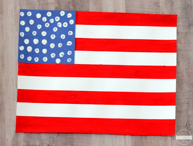 use white cotton balls in white paint to make dot stars on blue paper and tape to american flag