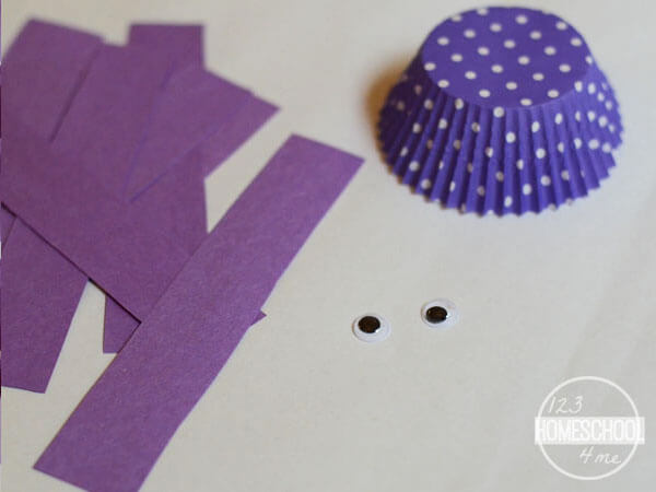 cupcake liners, construction paper, googly eyes, glue stick, kid scissors and markers