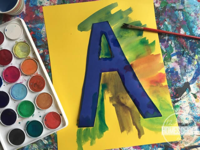 paint around the letter using watercolor paint