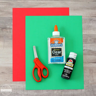 red and green construction paper, glue, black paint, and scissors