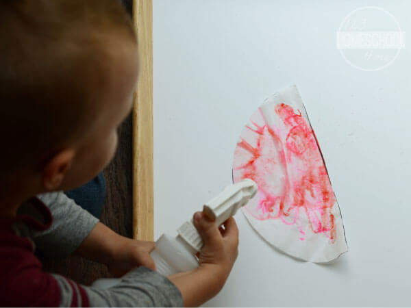 spray the coffee filter that is covered with markers to blend colors