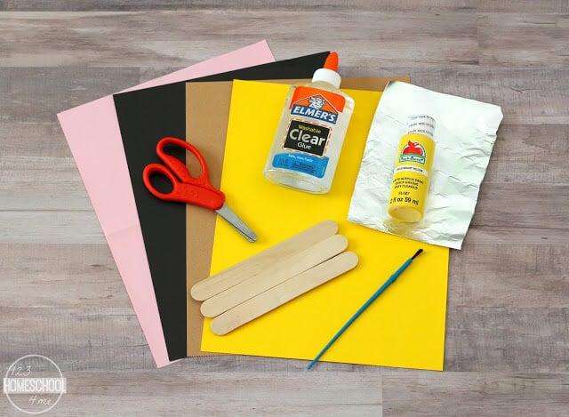 craft sticks, construction paper, paint, glue