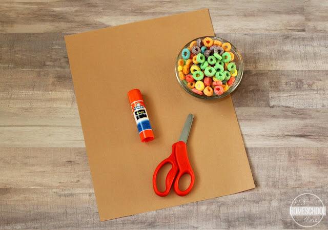 brown construction paper, fruit loops cereal, glue, and scissors