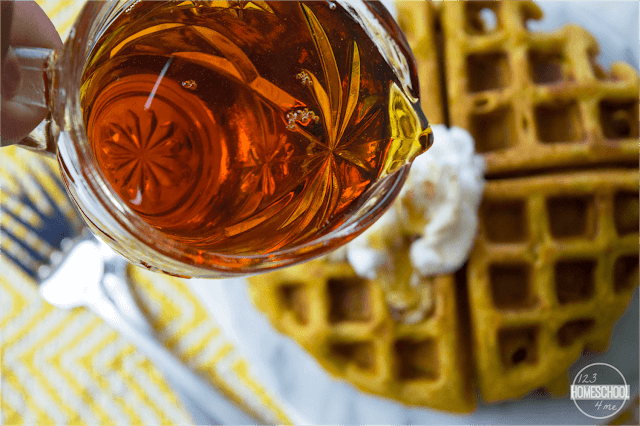 top pumpkin waffles with warmed maple syrup