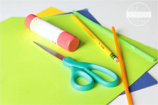construction paper, straw, scissor, pencil, and glue
