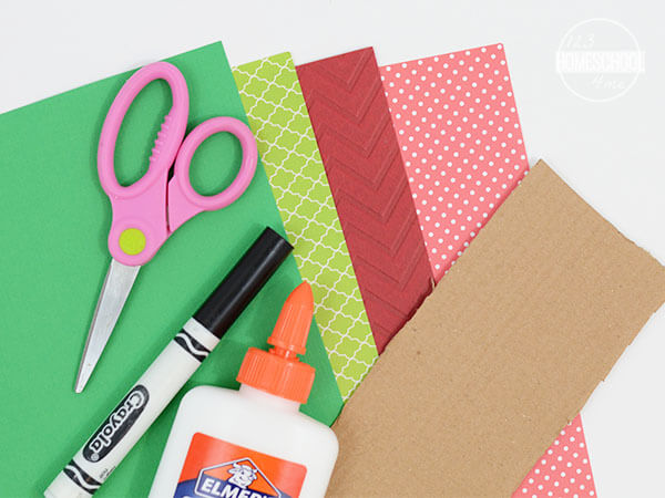 construction paper, scissors, markers, and glue