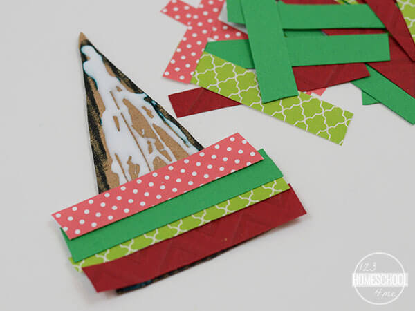 cut along the triangle to trip excess paper in this ornament craft for kids