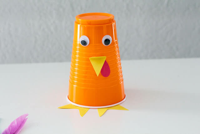 glue turkey eyes, beak, and feet to the super cute and easy turkey craft