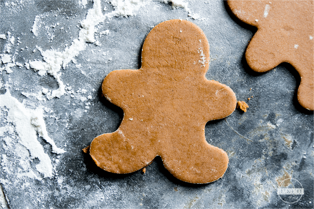 put gingerbread cookie cut outs on greased cookie sheet
