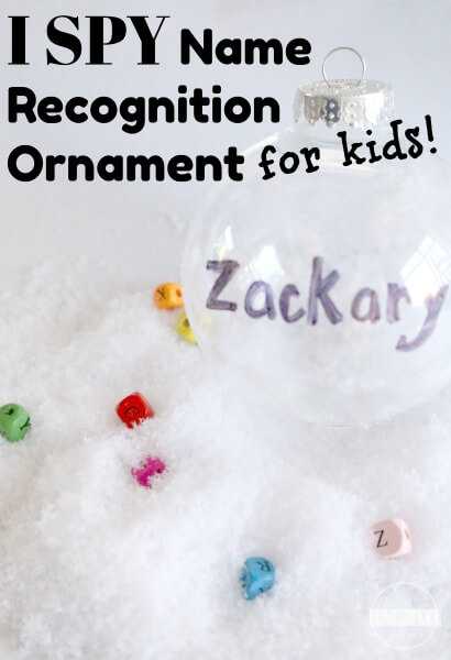 I Spy Name Recognition Ornament for Kids - Super cute and fun to make Christmas ornament kids can make! This is a super cute Christmas ornaments that are homemade and diy kids that makes a fun Christmas activity for kids, name recognition activity, and cute Christmas decoration for toddlers, preschool, kindergarten, first grade.
