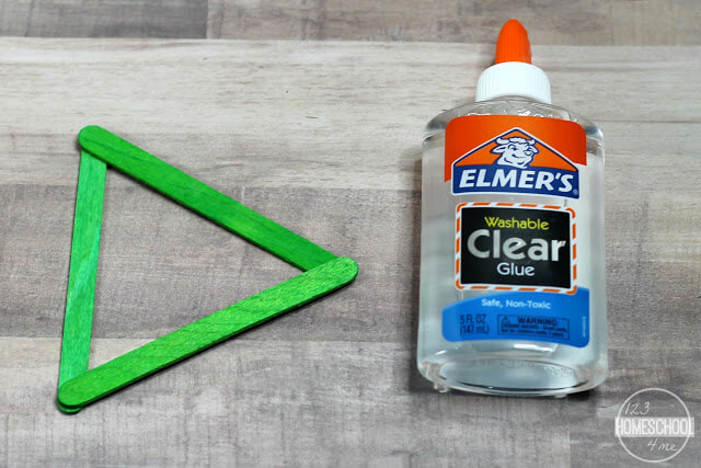 glue green Popsicle sticks together to make a triangle