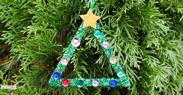 glue yellow craft foam star on top with string to hang the Christmas tree ornament