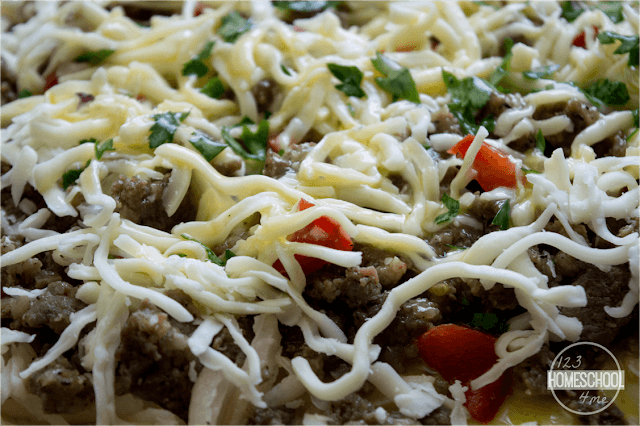 top with mozzarella cheese and green onions