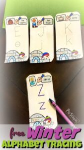 practice tracint upper and lowercase letters with these free winter alphabet cards