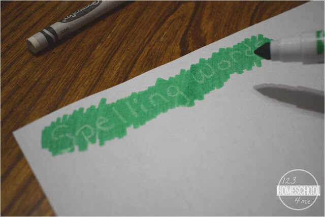 Color over the top of the white crayon word with marker to reveal your spelling word