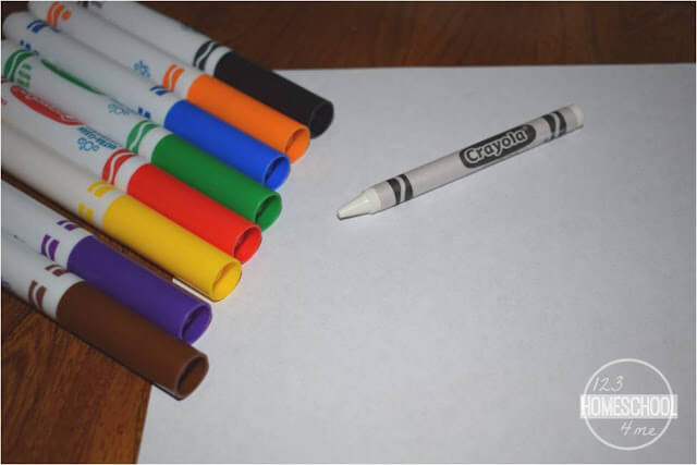 colorful spelling practice with white crayon and markers