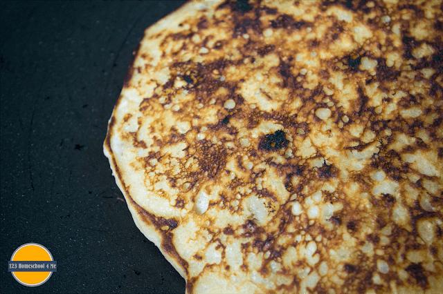pour pancake batter onto warm griddle and cook until godlen brown