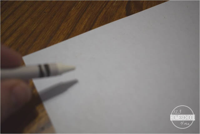 white your spelling words with the white crayon