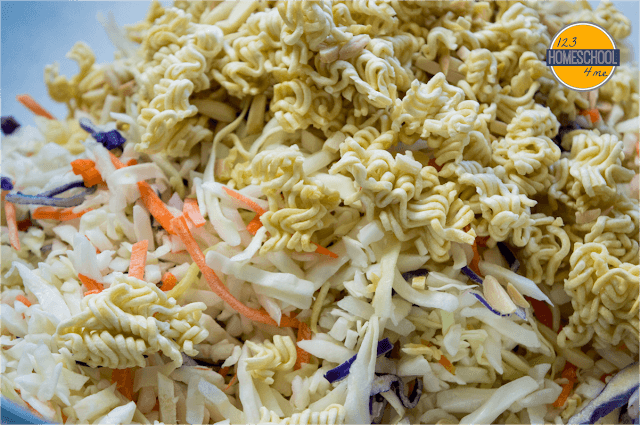 mix together coleslaw (cabbage and carrot) mixture and toss with toasted raman noodles and slivered almonds