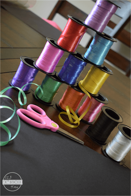 curling-ribbon-scissors-black-construction-paper