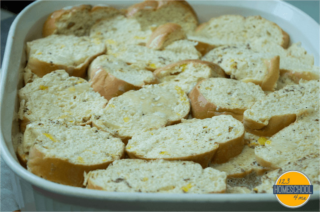 pour milk and egg mixture over bread slices in casserole dish
