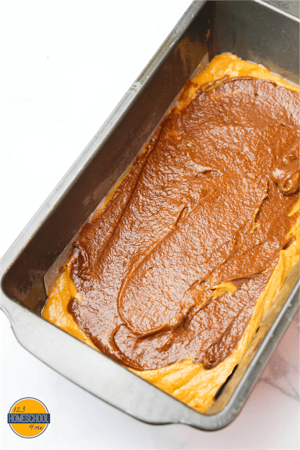 Top with the cocoa powder-infused batter and smooth down, then top with the remaining pumpkin batter.