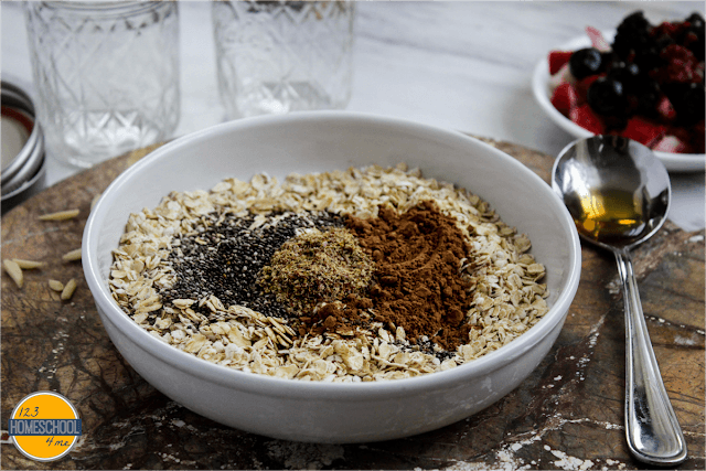 Mix together old fashioned oats, chia seeds, cocoa powder, milled flax seeds