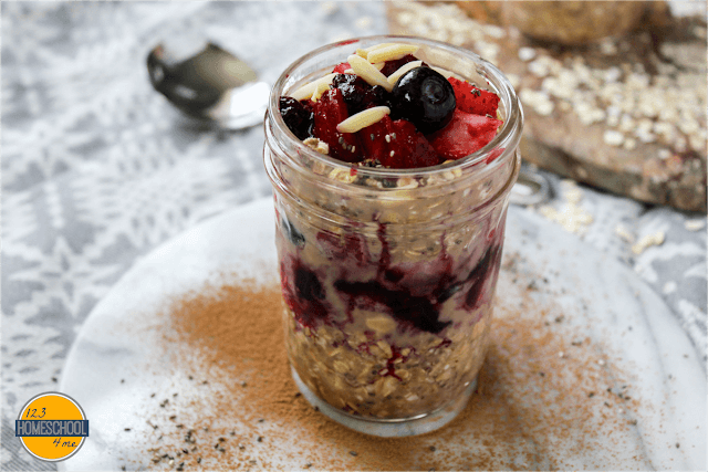 top chocolate oatmeal with mixed berries and slivered almonds