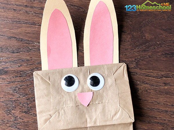 Glue ears, nose, and google eyes on the bunny easter craft for preschoolers