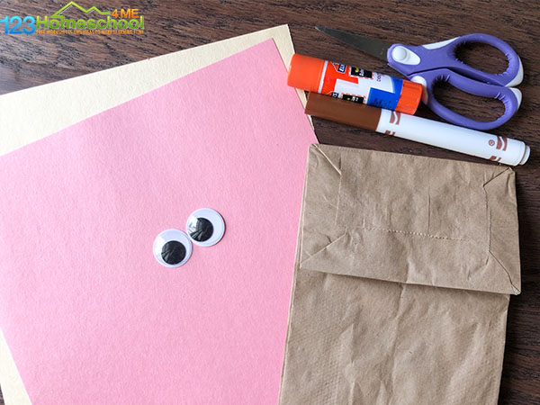 To make this easter paper bag crafts you need brown bag, pink and cream construction paper, google, eyes, glue, and a marker