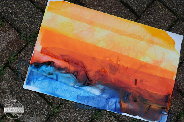 now put your part project out in the rain or spray with a water bottle to make color bleed in this bleeding tissue paper crayon rainy day craft for kids