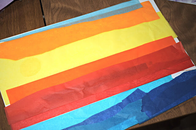 You can make a beautiful sunset craft for kids by layering strips of yellow, orange, and red