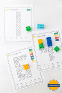 Fun, hands on preschool math activity with free printable preschool worksheet, duplo bricks, and dry erase markers to practice tracing letters