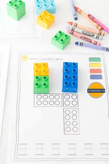 Kids will have fun tracing numbers with these number mats that use lego bricks to practice counting with toddlers, preschoolers, and kindergartners