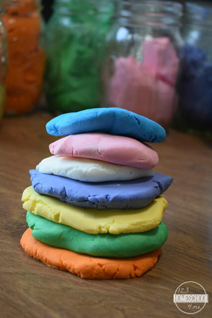 This moldable homemade cloud dough recipe is soft to the touch and fun to stack up in color patties.