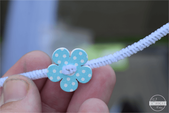 sew-buttons-into-summer-bracelet-craft-for-kids