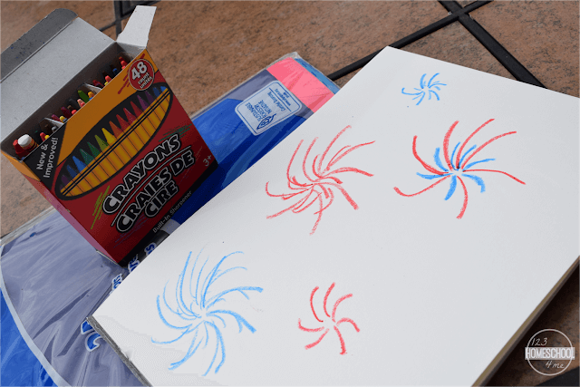 using-crayons-draw-fireworks-on-the-paint-paper