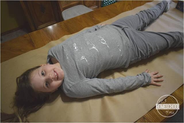 kids will trace their bodies on butcher paper to make their own my body project