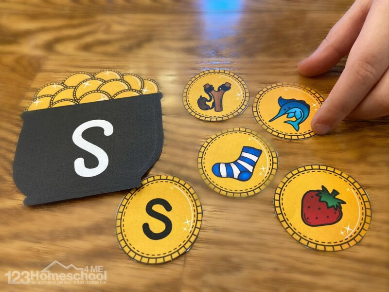 letter s pot of gold with gold coins featuring lowercase letter s, swordfish, slingshot, socks, and strawberry