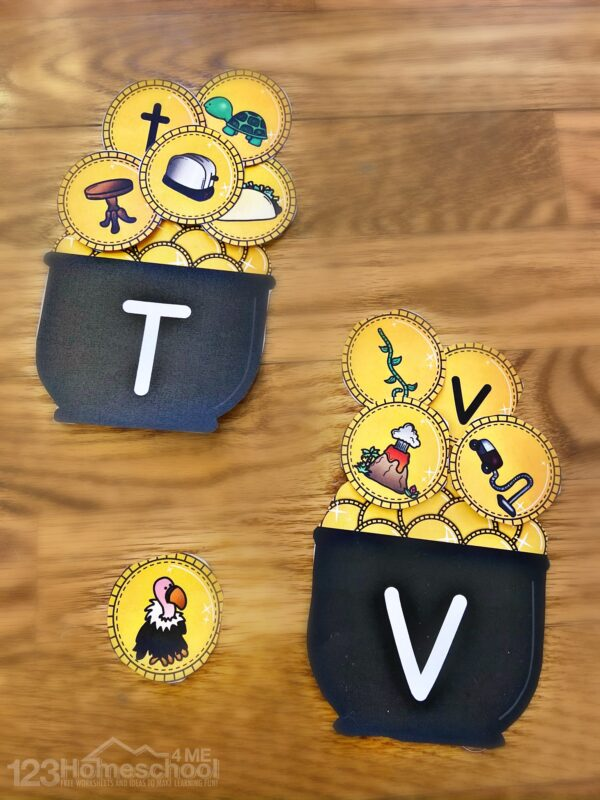 letter t and letter v pots of gold with gold coins featuring table, toaster, turtle, taco, vulture, vine, volcano, and vacuum