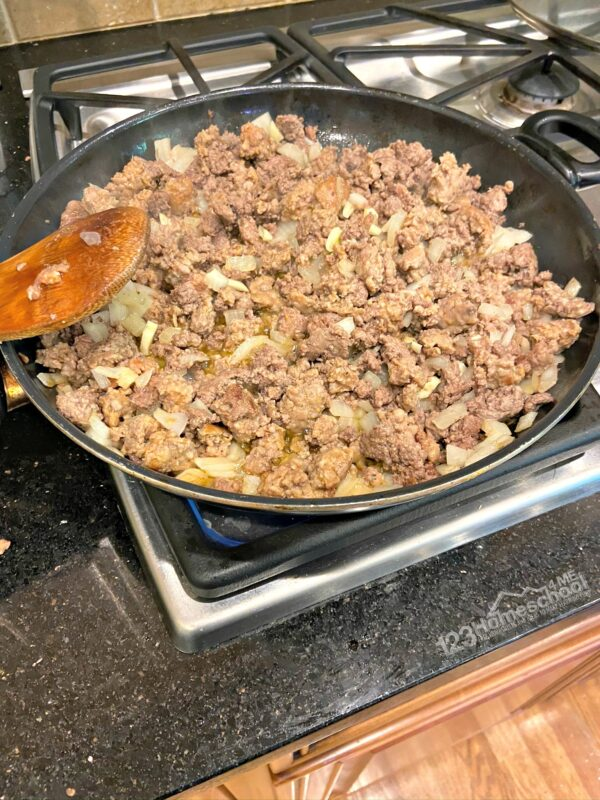 In a large skillet brown ground beef and ground pork, with onion and garlic