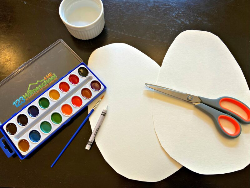 all you need to make this easy egg craft is paper, white crayon, watercolor paints, brush, scissors, and dish of water
