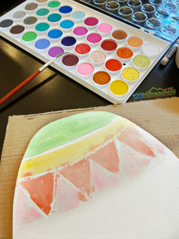 use watercolor resist paint technique to make beautifullly decorated easter egg craft for april