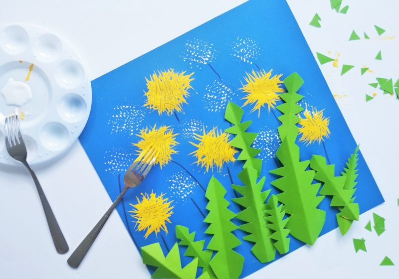 cut up green construction paper to make the dandelion leafs