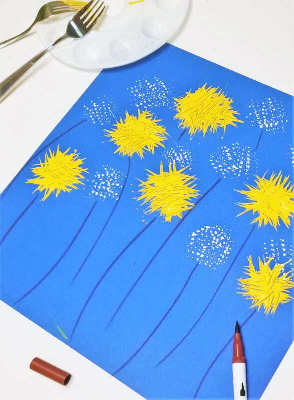 super cute summer flower craft using a fork, white paint and yellow paint on blue construction paper