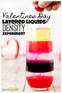 Looking for a fun valentines day science activity for February? This liquid density experiment is sure to be a hit with your toddler, preschool, pre-k, kindergarten and elementary age students in first grade, 2nd grade, and 3rd grade students. Children will be amazed as they watch the layered liquids stack up in pretty valentine's day colors for an EPIC valentine science experiments that kids will remember fondly. This valentines day activityis a great way to teach kids what is density for kids with a fun, hands-on, pretty density experiment.